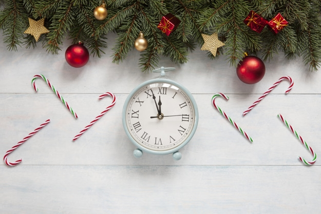 Christmas holiday background with vintage alarm-clock, balls, st